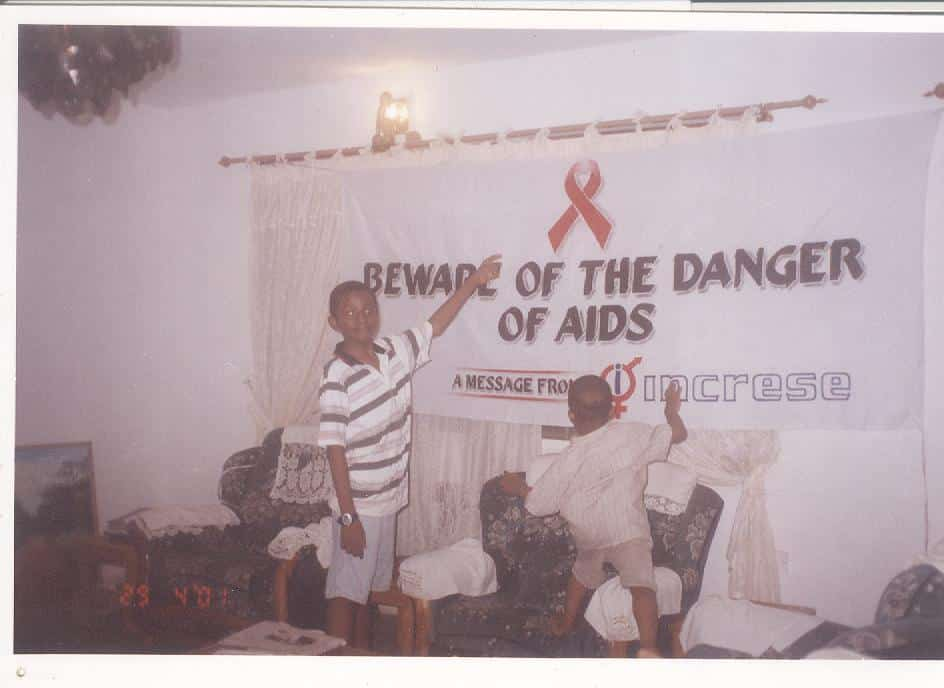2001, Gbagada, Lagos State: Dorothy's older kids [Samson and Samuel Aken'Ova] messing around with the campaign banner designed and left to dry by their father, George Aken'Ova.