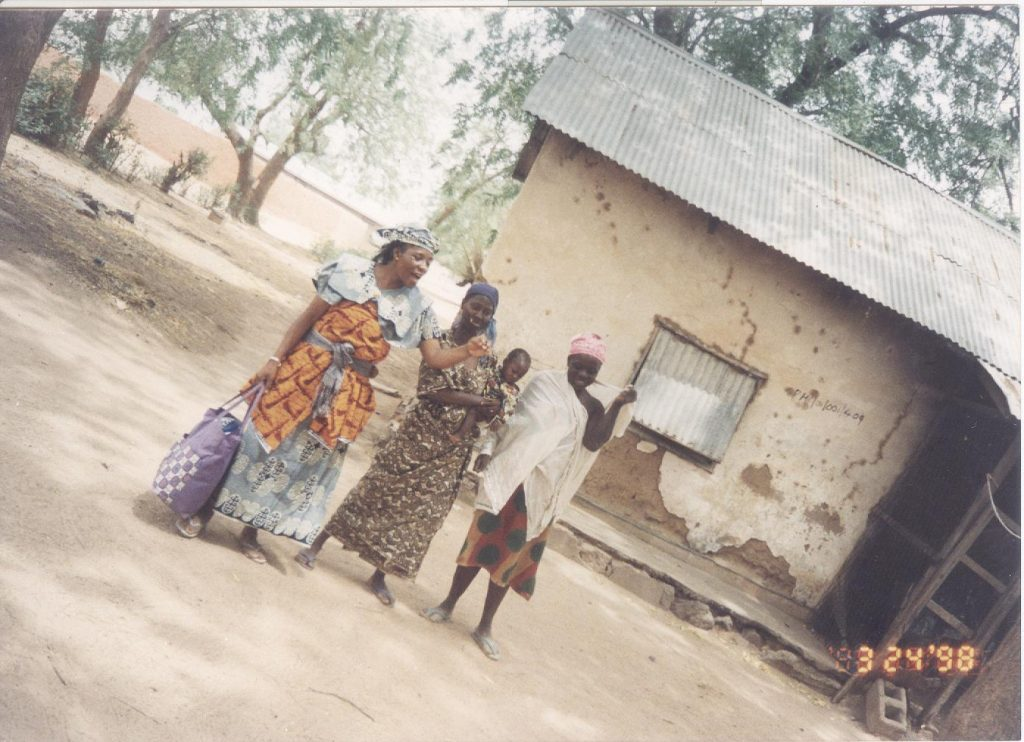 1998: Cesnabmihilo Dorothy Aken'Ova visiting her childhood compound at the ECWA Mission Quarters in Gumi, Sokoto State, while consulting as the Programme Person, Volunteer Health Workers Training Sessions.