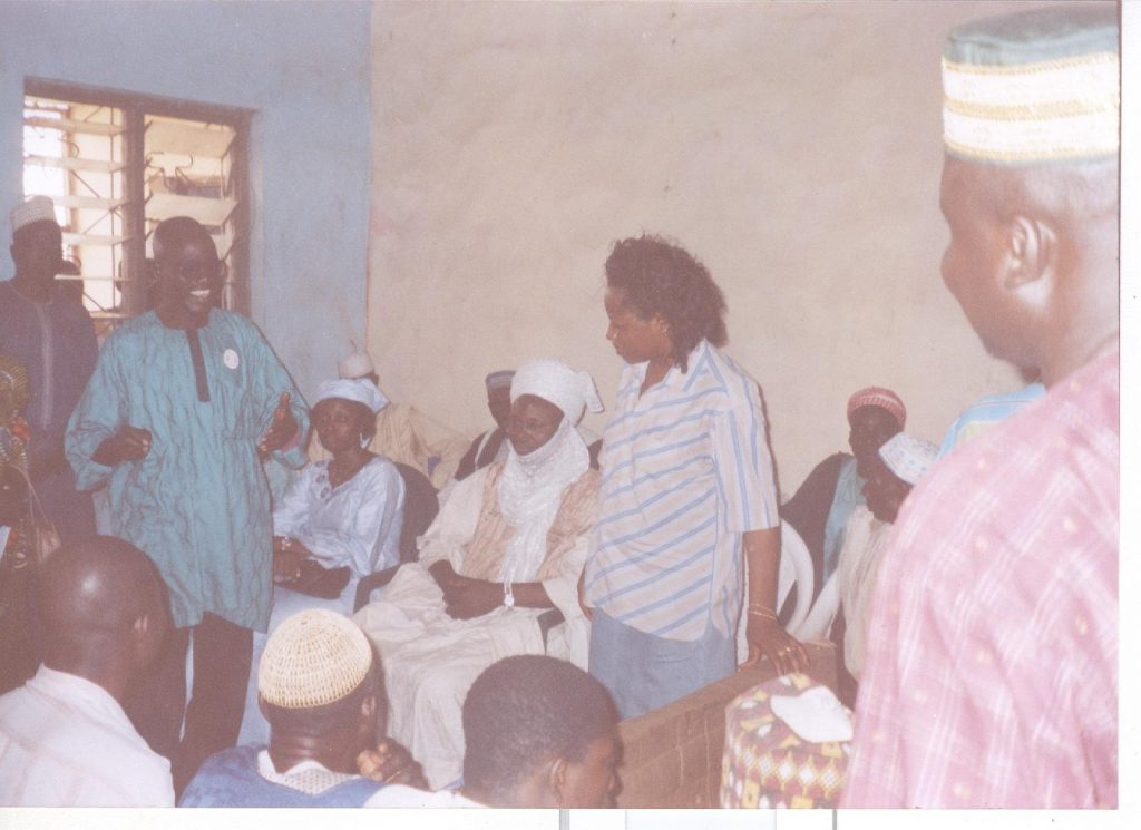 Advocacy Visit, circa 2003: Cesnabmihilo Dorothy Aken'Ova at a meeting with the Hakimi (District Head) of Doko, Niger State, and other Community Leaders.